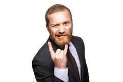 Смешной бизнесмен делая рожок показывать - знак рок-н-ролл Стоковое Фото