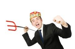Смешной бизнесмен при изолированная вила трёхзубца Стоковое Изображение RF