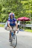 Смешной велосипедист дилетанта во время Le Тур-де-Франс стоковая фотография