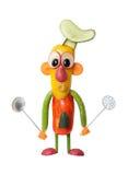 Смешной кашевар сделанный овощей с ложками кухни стоковые изображения rf