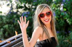 смешной красный цвет сердца стекел девушки Стоковая Фотография RF