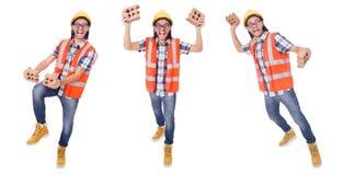 Смешной молодой рабочий-строитель при сломленный кирпич изолированный на wh Стоковые Фото