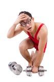 Смешной парень с dumbbels Стоковая Фотография RF