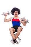 Смешной парень с dumbbels Стоковые Фотографии RF