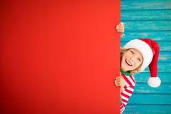 Смешной ребенк держа пробел знамени картона Стоковая Фотография