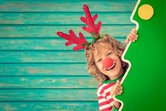 Смешной ребенк на Рожденственской ночи стоковая фотография rf