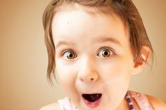 смешной усмехаясь ребенк стоковое изображение