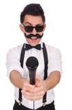 Смешной человек при mic изолированный на белизне стоковые фото