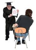 Смешной школьный учитель, ранг слабости студента плохая стоковые фотографии rf