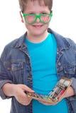 Смешной школьник в зеленых стеклах - изолированных на белизне стоковые изображения