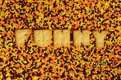 смешно Слово от съестных писем лежит на застекленном powde стоковое изображение rf
