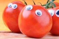 Смешные томаты стоковые фотографии rf