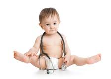 Смешным пеленка weared младенцем с стетоскопом Стоковая Фотография