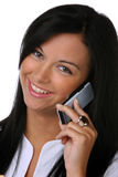 смеясь над детеныши женщины мобильных телефонов Стоковое фото RF