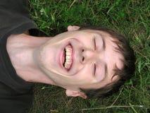 смеясь над детеныши человека Стоковое Фото