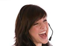 Смеясь над женщина с шлемофоном Стоковые Фото