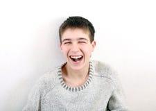 смеясь над подросток Стоковые Фото