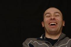 смеясь над человек Стоковая Фотография