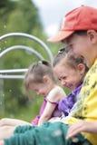 3 смеясь над дет играя на озере Стоковая Фотография RF