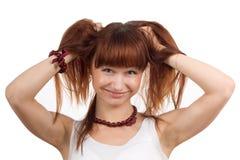 Смеясь над женщина задерживая волосы Стоковое Фото