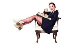 Смеясь над женщина на кресле Стоковая Фотография