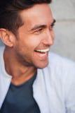 Смеясь над красивый человек Стоковые Фото