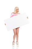 Смеясь над маленькая девочка проводя пустой плакат Стоковые Изображения RF