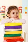 Маленькая девочка с книгами Стоковые Фотографии RF