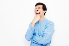 Смеясь над парень над белизной Стоковая Фотография RF