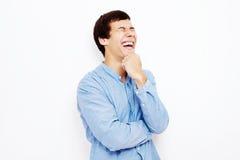 Смеясь над парень над белизной Стоковая Фотография