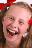 смеяться над девушки Стоковая Фотография