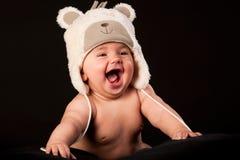 смеяться над крышки медведя младенца Стоковое Фото
