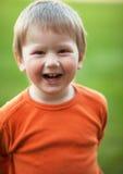 смеяться над мальчика Стоковая Фотография