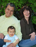 смеяться над семьи младенца Стоковая Фотография RF