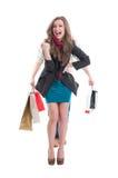 Смеяться над женщины покупок стоковые фото