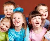 смеяться над малышей Стоковая Фотография
