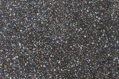 Смолотая текстура вымощающ предпосылку серого цвета булыжника на открытом воздухе стоковые изображения