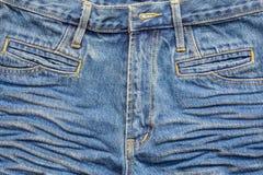 Сморщенные голубые джинсы Стоковое Изображение RF