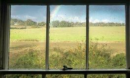 Смотреть вне к радуге Стоковое Фото