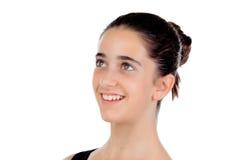 Смотреть вскользь девушки подростка усмехаясь вверх Стоковое Изображение RF