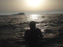 Смотреть заход солнца Cala Comta в Ibiza Стоковое фото RF