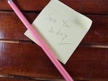См. вас сегодня на бумаге стикера с розовым карандашем стоковые изображения