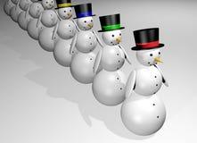 Снеговики в ряд Стоковая Фотография RF