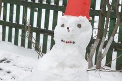 Снеговик в красном ведре Стоковое Фото
