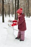 снеговик девушки маленький лежа был Стоковые Фото