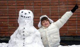 снеговик девушки Стоковое Изображение RF