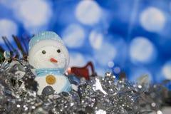 Снеговик на bokeh для предпосылки рождества Стоковое Изображение RF