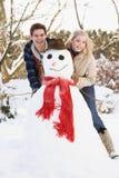 снеговик пар здания подростковый Стоковая Фотография