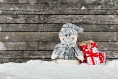 снеговик подарков рождества предпосылки Стоковая Фотография