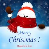 Снеговик рождества милый с шляпой шарфа и Санта Клауса красного цвета, развевая рукой Стоковая Фотография